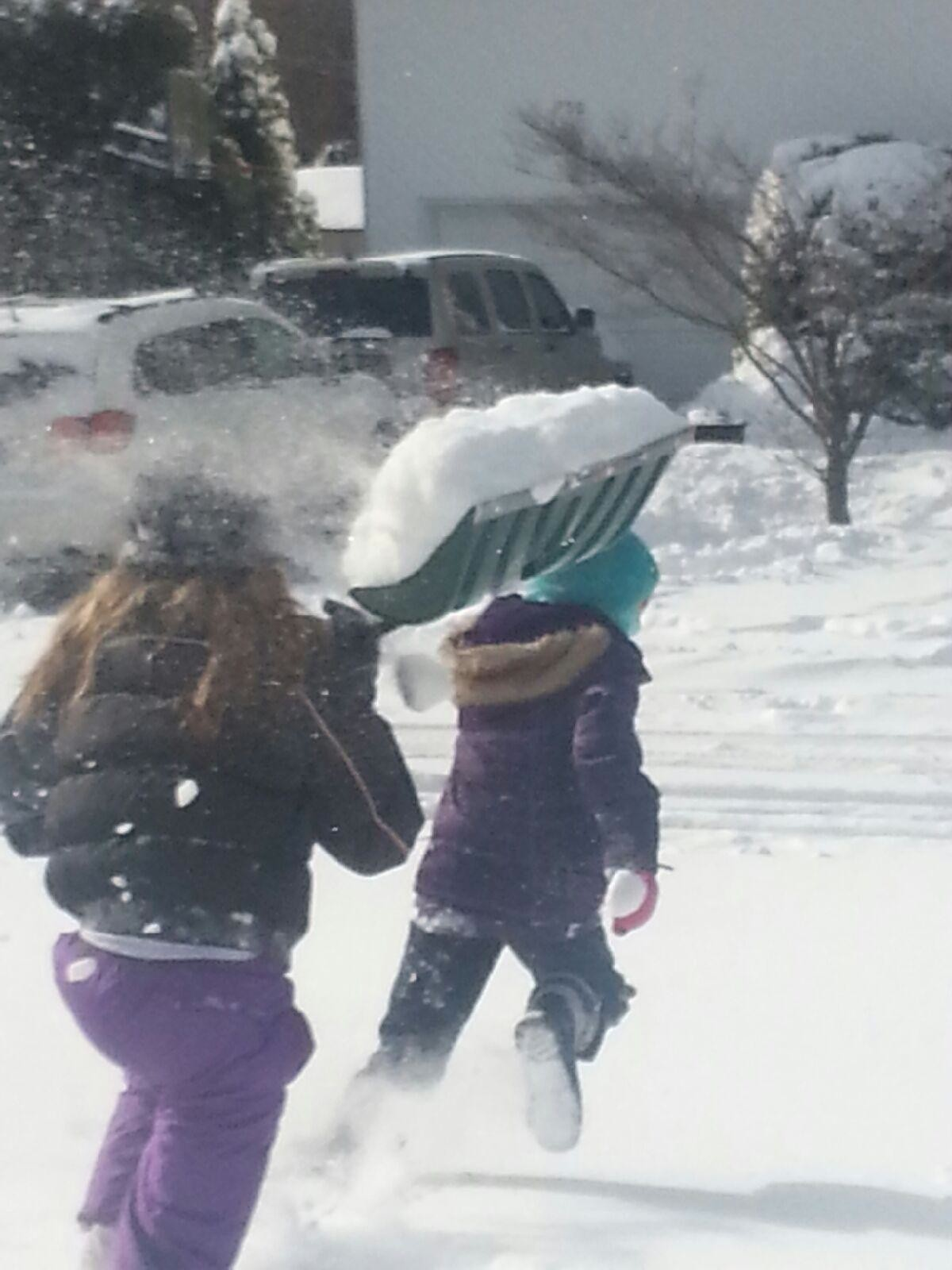 Abigail Pallotta ran for her life as her sister Alyssa tried to douse her with snow