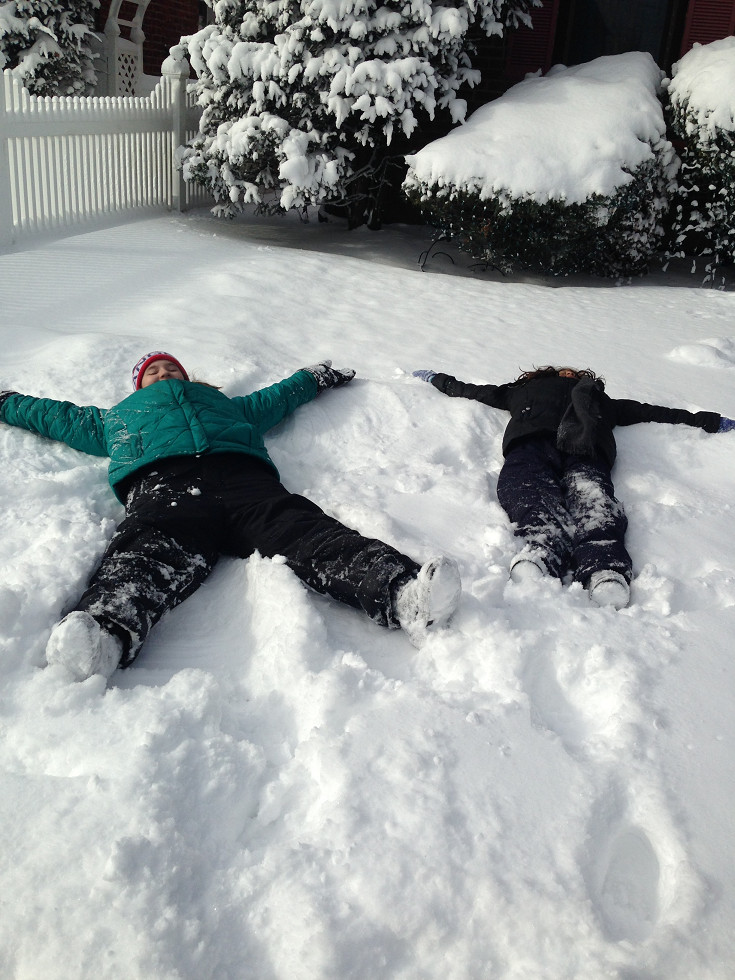 Making snow angels was a popular activity for children in Valley Stream on Friday.