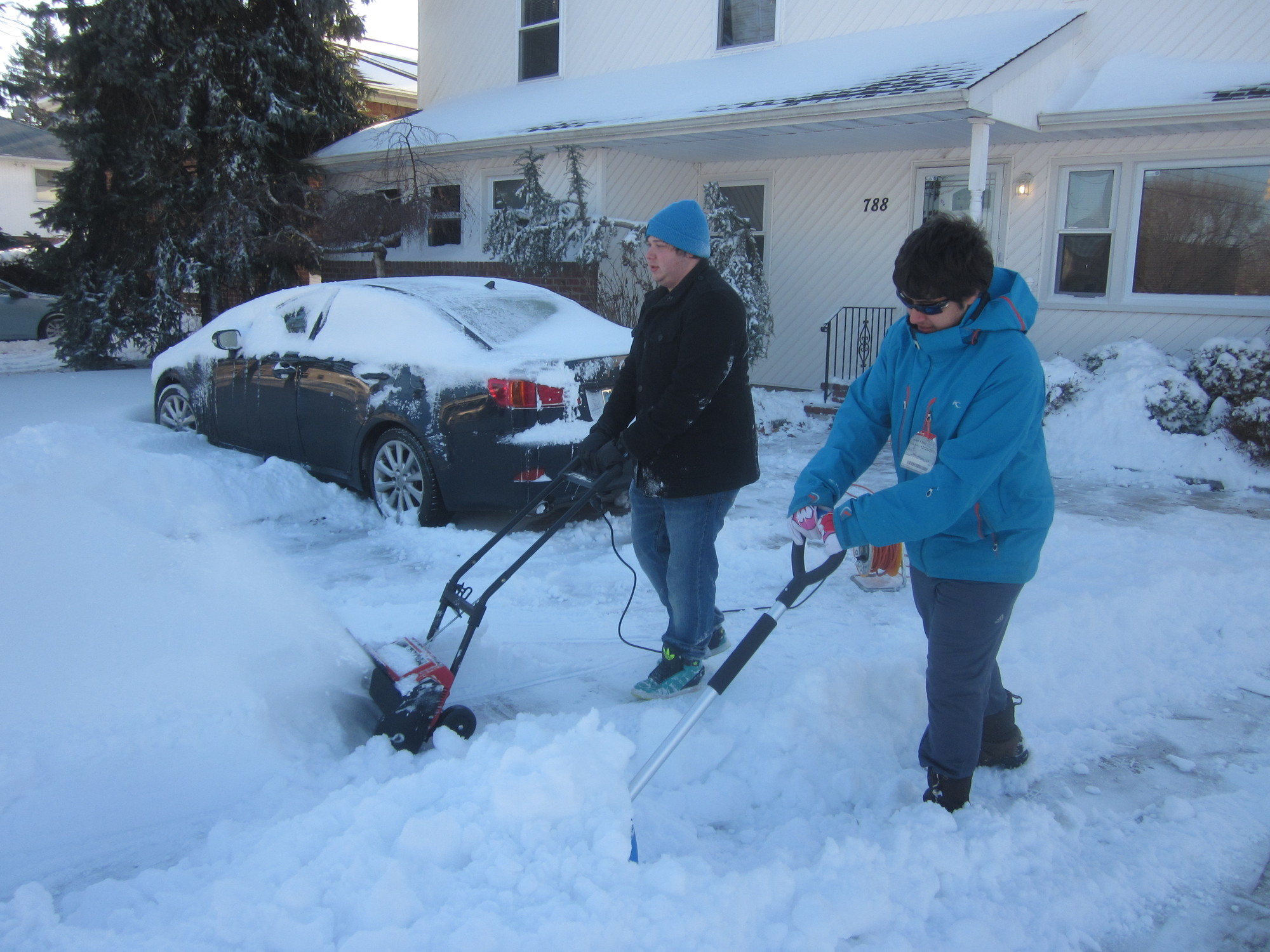 Brothers James and Paul Sarris shoveled their Merrick Avenue home.