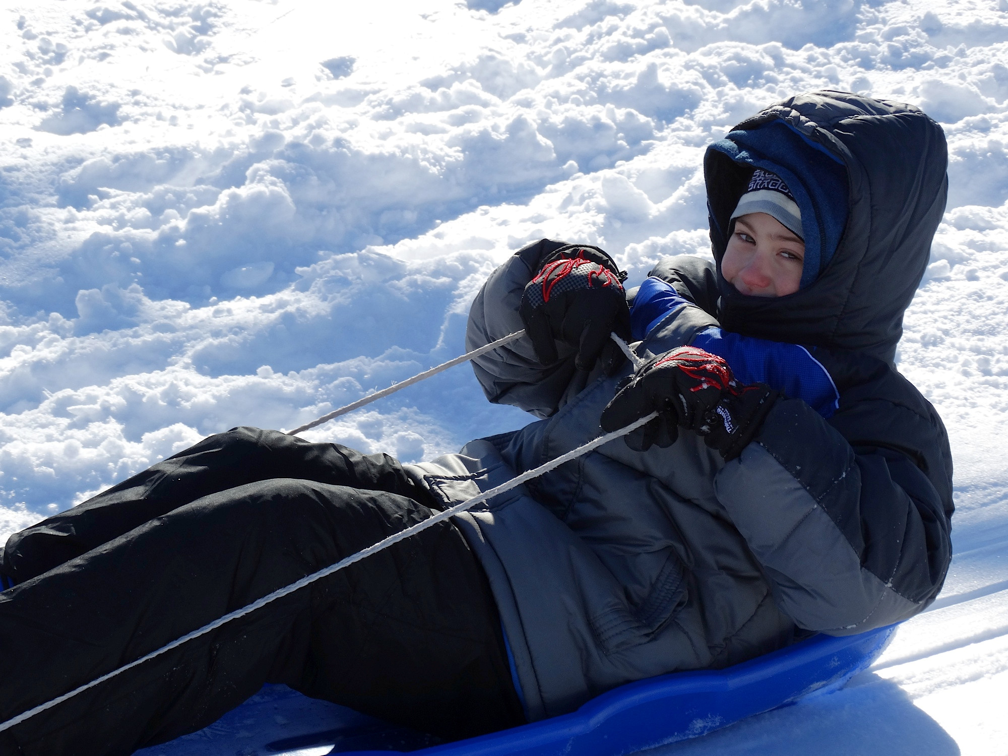 Michael Houlihan, 9, of Valley Stream, spent part of the day sledding at the Westwood train station.