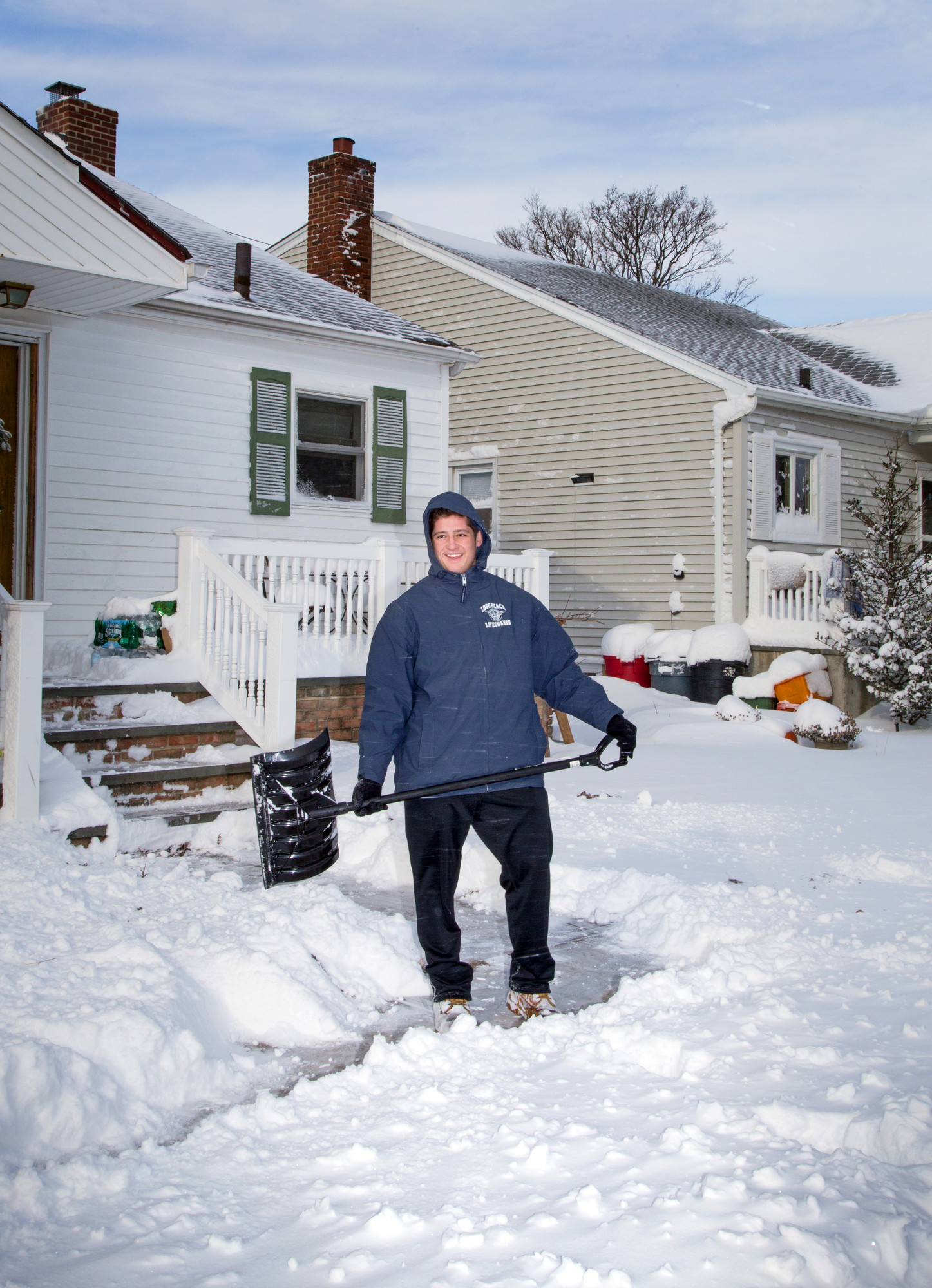 Lifeguard Rob Delury shoveled out his home on Harmon Street.