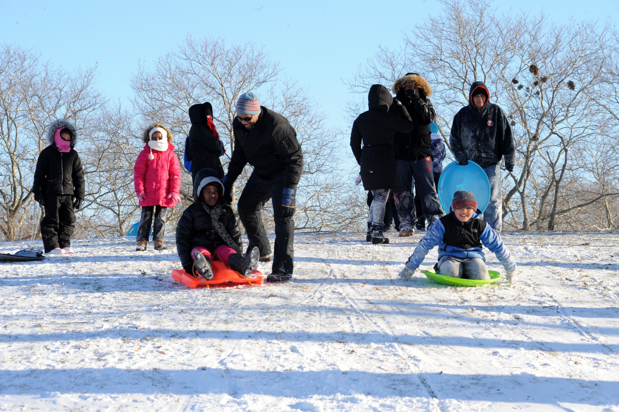 A hilly area near Harry Chapin Lakeside Theatre was the popular spot for sledding last week.
