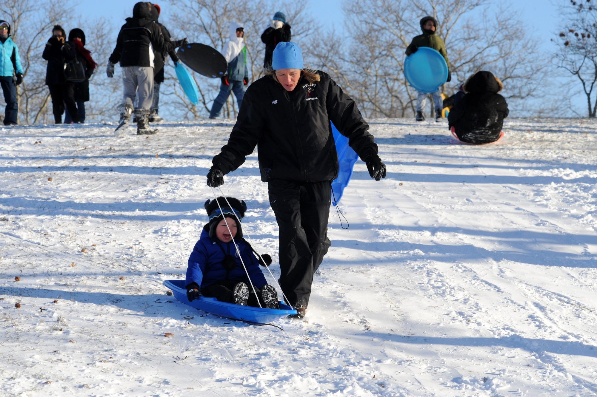 Susan Lyke guided her son Jack, 4, down the hill.
