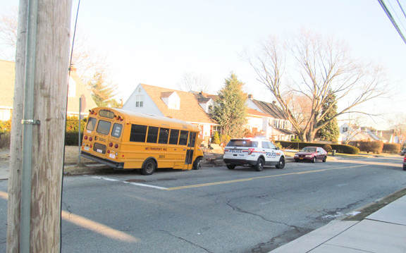 A small school bus slid off Bellmore Road and struck a tree on Thursday around 4 p.m.. No injuries were reported, according to police.