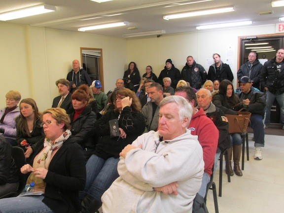More than 75 residents crowded into Village Hall for the meeting.