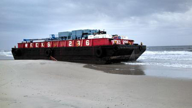 The barge ran aground at Silver Point County Park after the tugboat towing it sank off Atlantic Beach on Jan. 13.