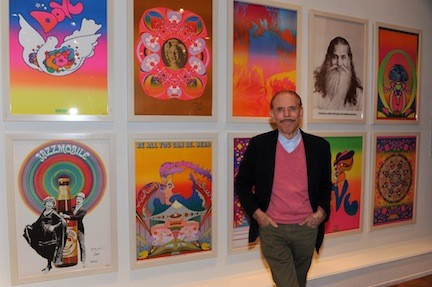 An artist's odyssey: Peter Max stops by a wall of his iconic posters during a visit to Nassau County Museum of Art. The posters, along with paintings and drawings continue to delight visitors to the museum. Max will be back at the museum on Feb. 2 to sign books and posters.