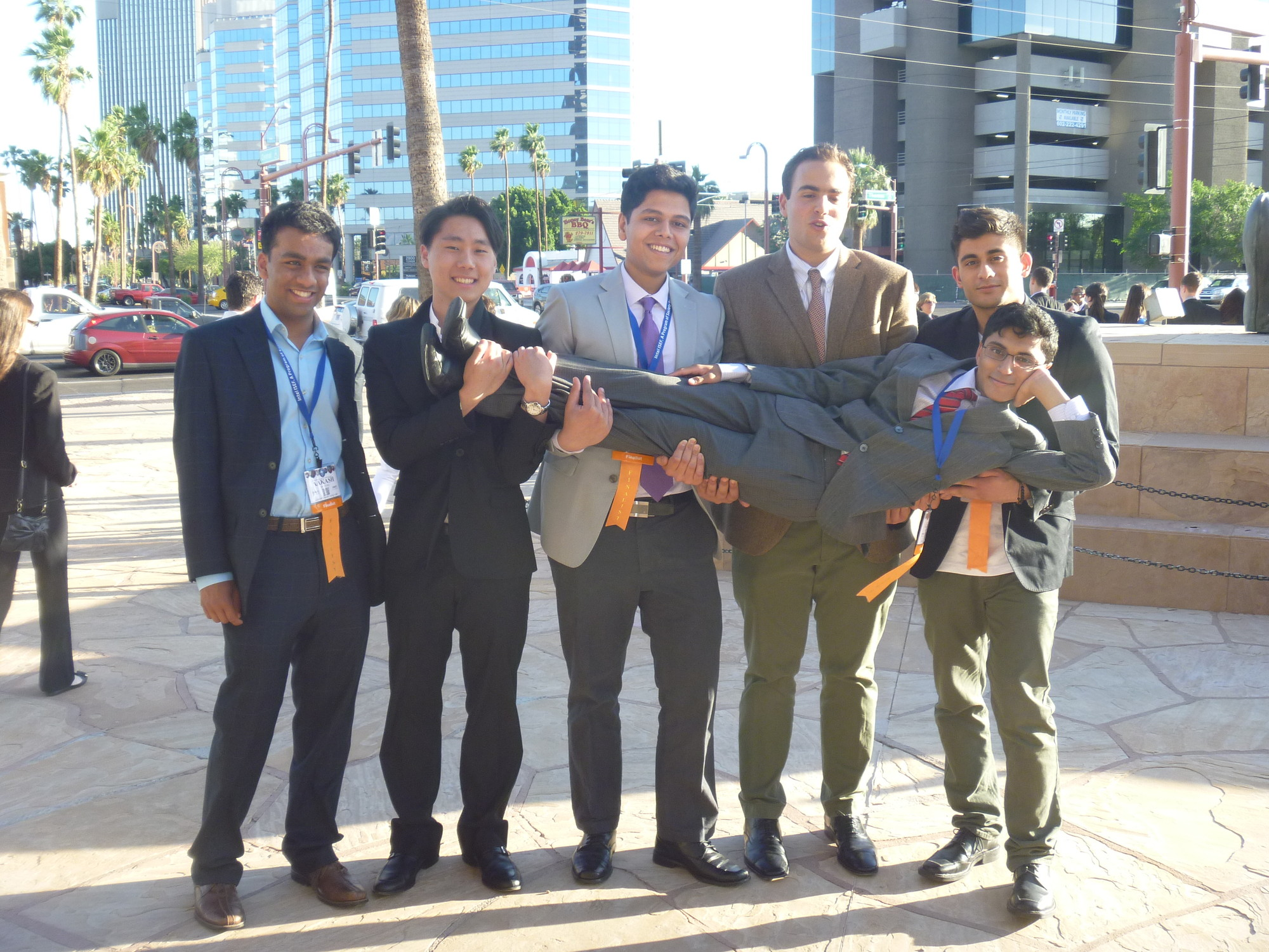 At the International Science and Engineering Fair in May in Phoenix, he was hoisted by his friends, from left, Aakash Jhaveri, Albert Kim, 2013 East Meadow High School graduate Shujat Khan, Benjamin Pleat and Shamoon Rizvi, another 2013 EMHS graduate.