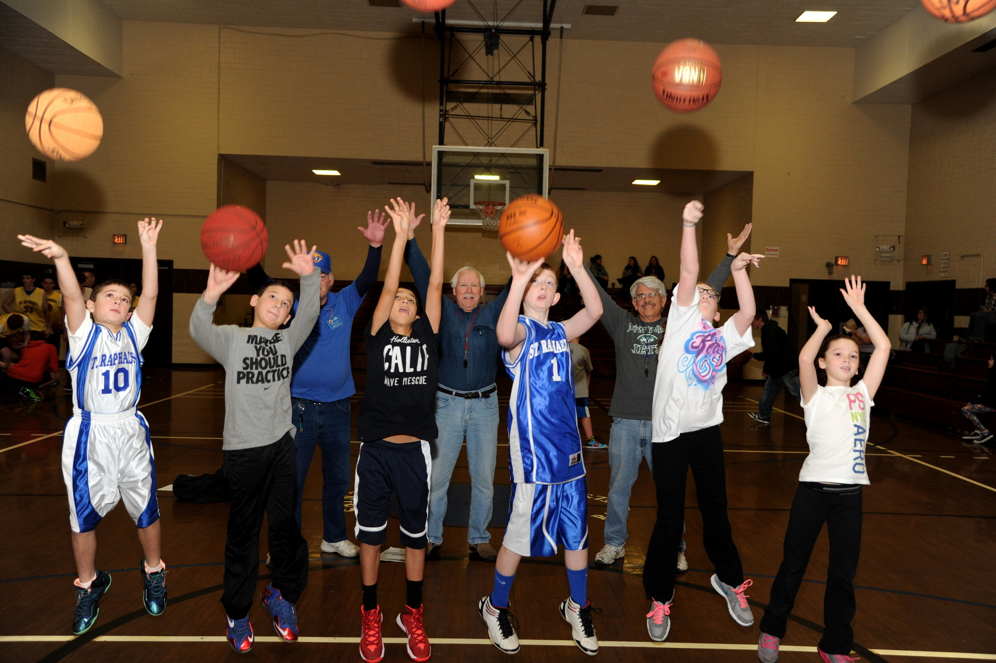 Nicholas Giardino, 9, far left, Jordan Chalmers, 10, Tyler Luciano, 12, Brendan Wilkowski, 11, Kerry Clark, 11, and Lindsay Solenski, 9, were among the winners of the Pope Pius XII Knights of Columbus annual free throw contest last Saturday at St. Raphael's Parish. Behind them, event organizers John Devany, partially obscured at left, Paul Wissert and Alan Bacci cheered them on.