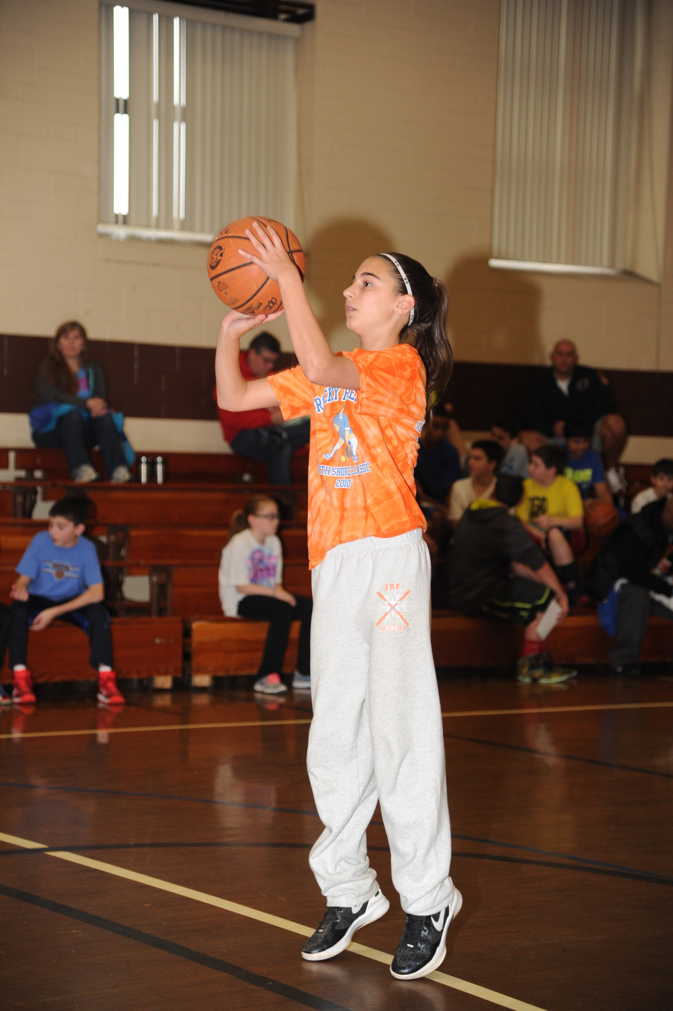 Hannah Arbuse, 13, lined up her shot in the gymnasium of St. Raphael's parish.