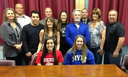ToniMarie Valeriano, left, and Christine Rizzacasa will play softball in college next year. They are pictured here with family members and Mepham administrators and coaches.