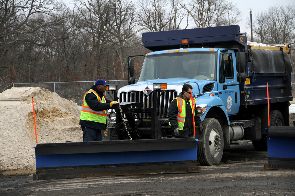 Town snow salting and plowing crews are combating what officials described as the second major snowstorm of 2014.
