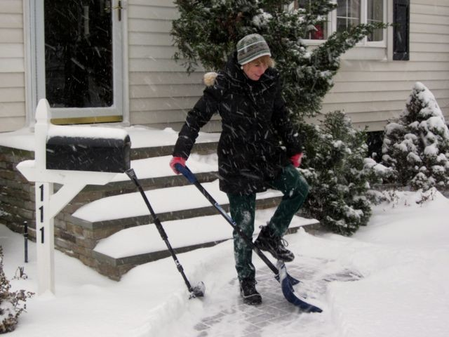 Jennifer McTague finished cleaning up the walk of her Burtis Avenue home, for what will likely be the first time of many over the next two days.