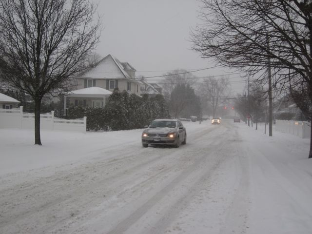 Cars struggled to reach speeds of more than 15 miles per hour early Tuesday evening as snow continued to fall.