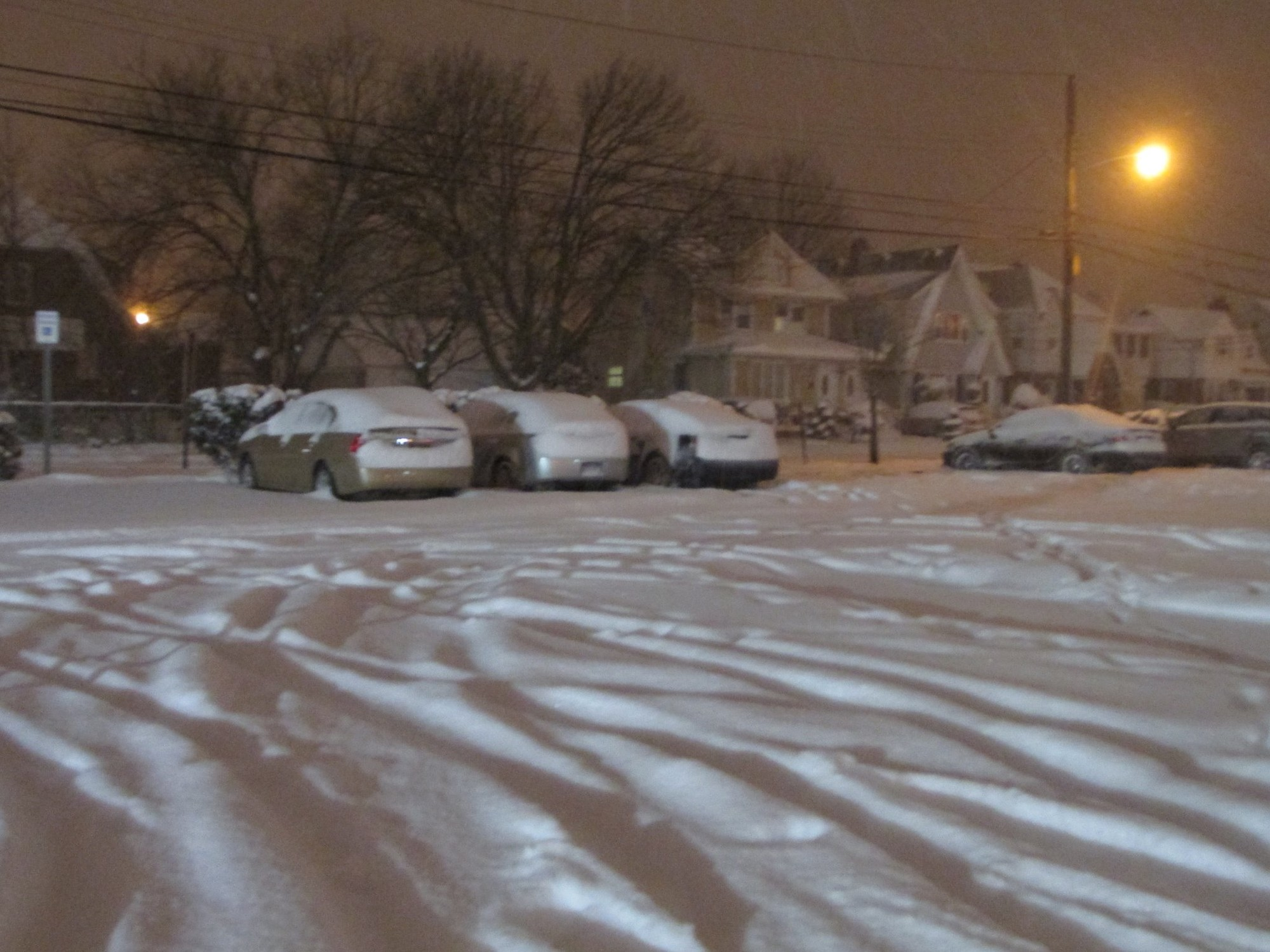 Several cars were snowed in at a municipal lot in Valley Stream.