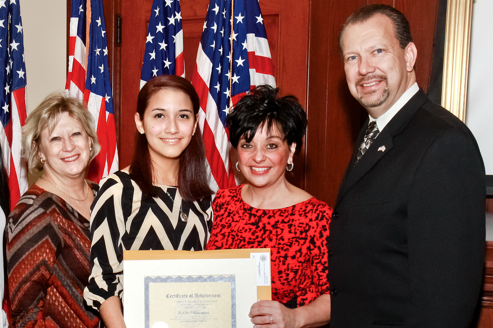 County officials honored Ashley Villanueva and other contest winners last week. From left are South Principal Maureen Henry, Villanueva, Linda Mangano and South teacher and Valley Stream Mayor Ed Fare.