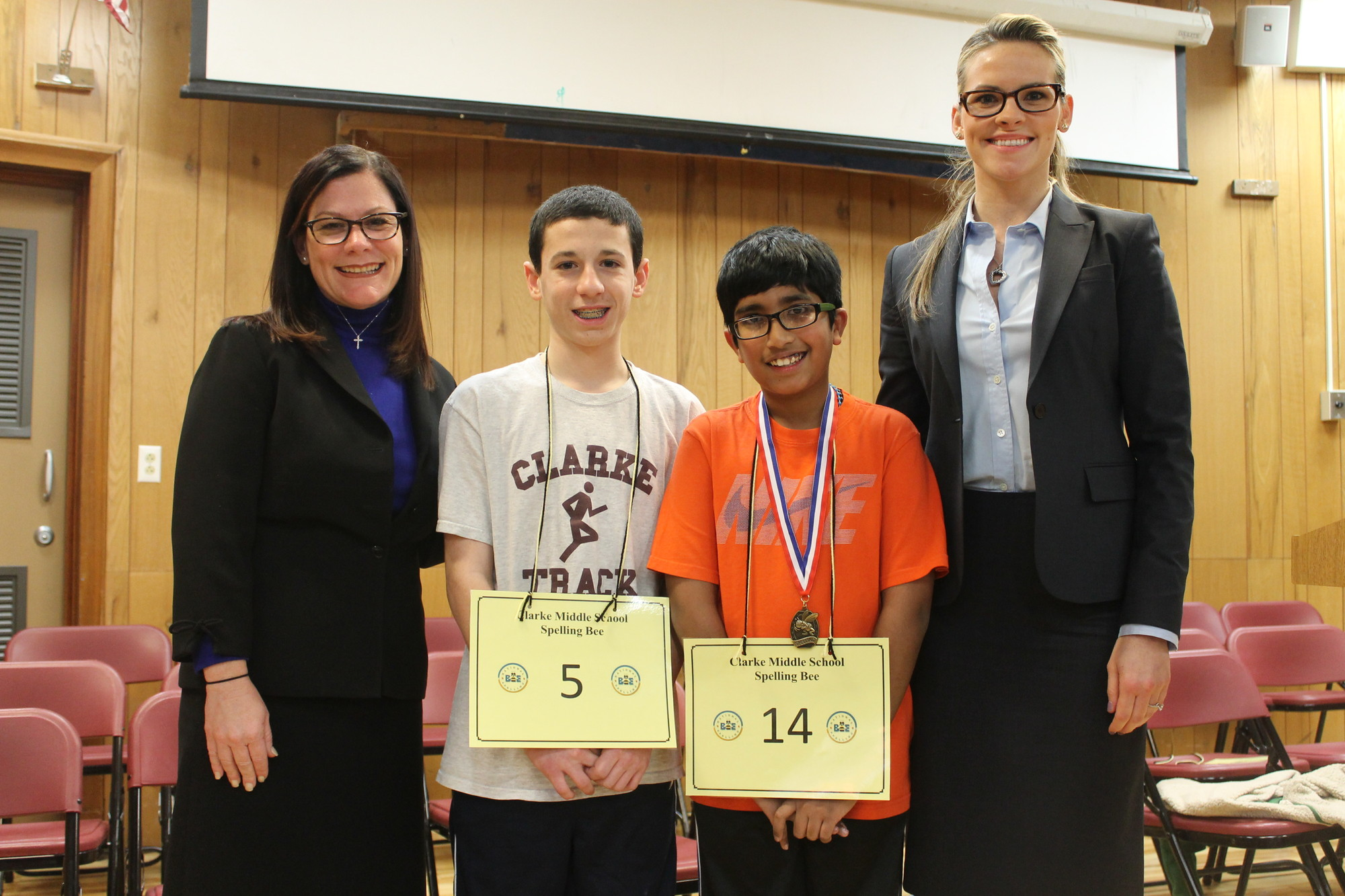 W.T. Clarke Middle School Principal Stacy Breslin, student Joe Collica, first-place winner Joel Matthew and Cinthia Serowik after the school's recent annual spelling bee.
