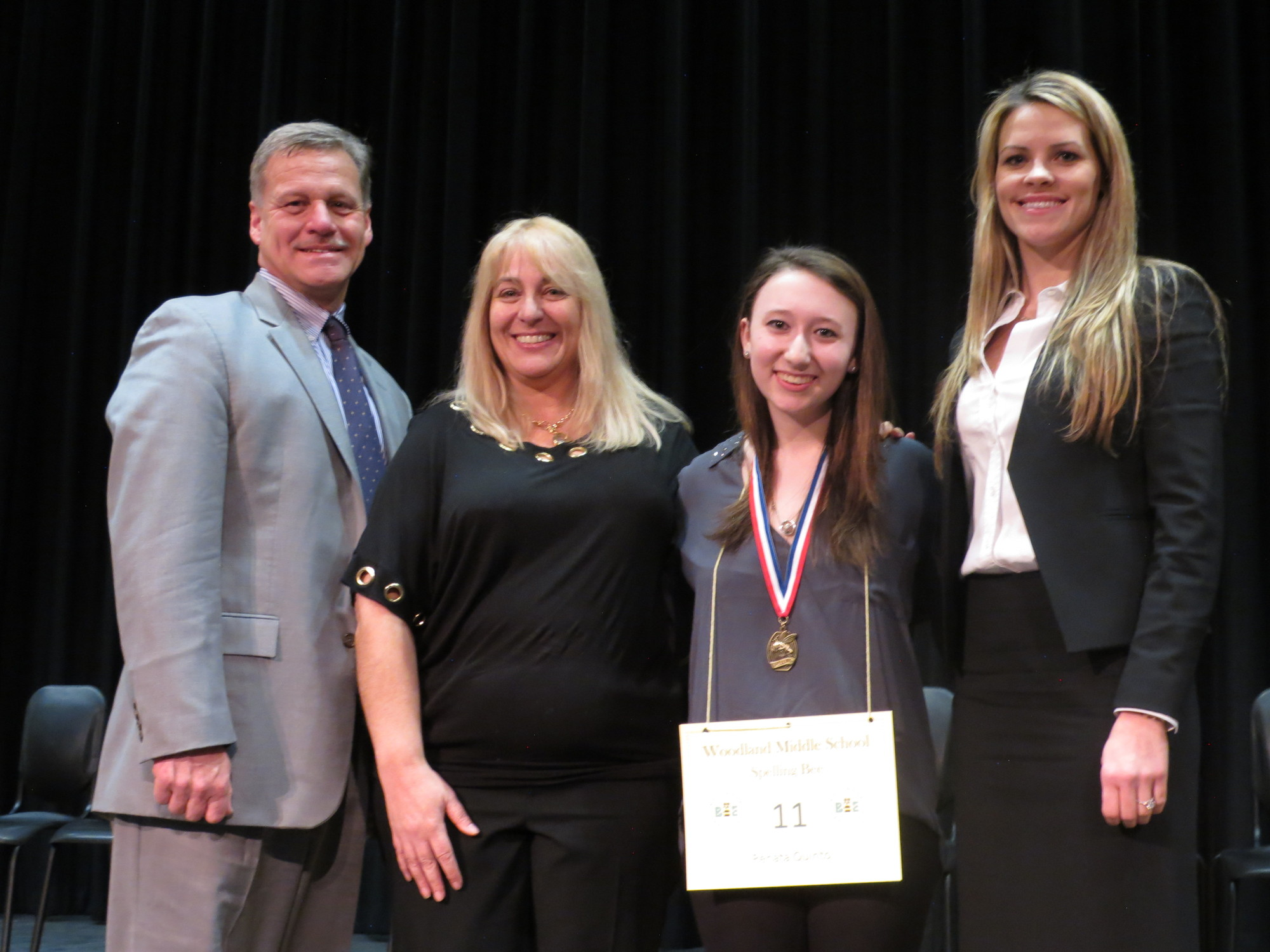 Woodland Middle School Principal James Lethbridge, left, English teacher Stacie Moisa, first-place winner Renata Quinto and Cinthia Serowik, chairperson of English Language Arts.