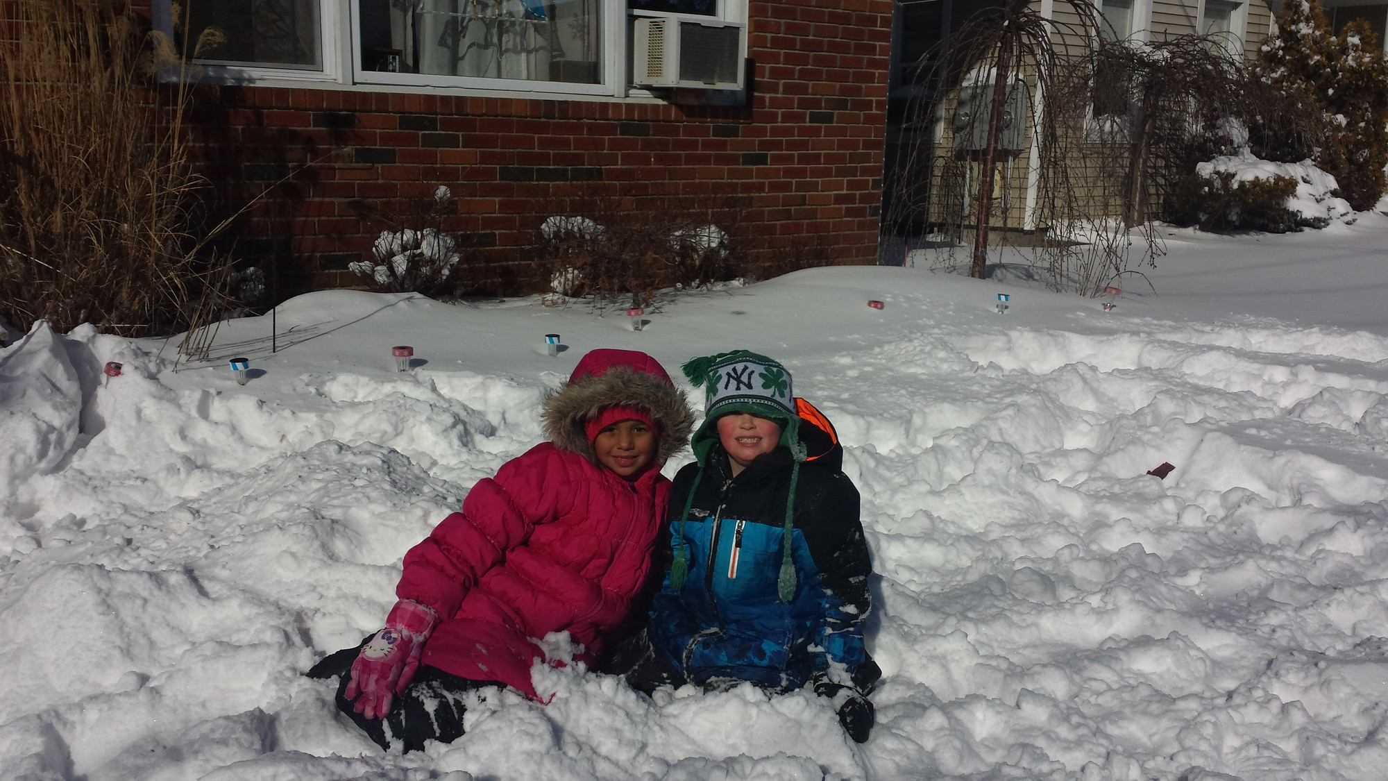 Bella Rush and Danny Casey enjoyed the snow outside of a Fifth Street home in Valley Stream on Wednesday.