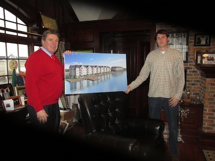 John Vitale, left, and his son, Dylan, showed off an artist's rendering of the two rental unit buildings he is planning for Island Park.