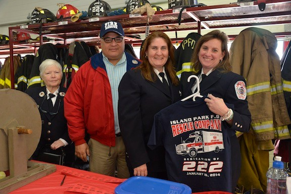 "Former Captain Kathryn Silliman, Crew members Alan Greenfield, Susan Pererson and Maryanne Baldino sold T-shirts and raffles as fundraisers for the Rescue Company at the ""wet down ceremony"" in Island Park."