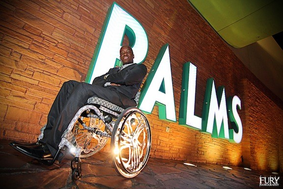 "Christian Ekunwe has worked as a VIP host at the Palms Casino Resort in Las Vegas for two years, creating his own ""brand"" on the local club scene based on his disability, despite some club owners who saw him as a liability in the past."