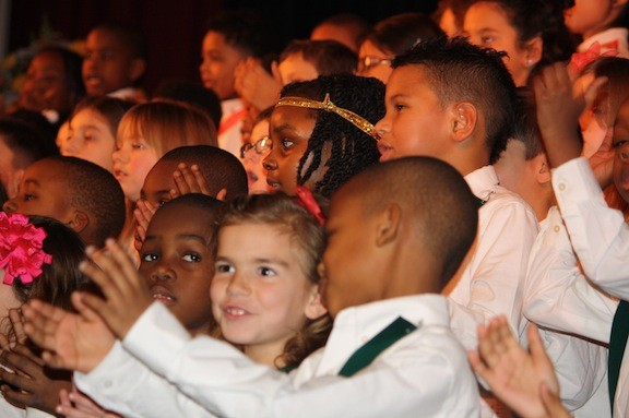 "First-and second-graders sang ""Men of Peace"" at the ceremony."