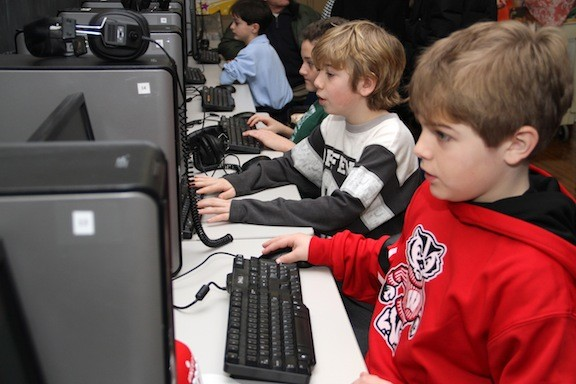 Seamus Kieran, left, and Aidan Ward played on computers to kick off Catholic Schools Week on Jan. 26.