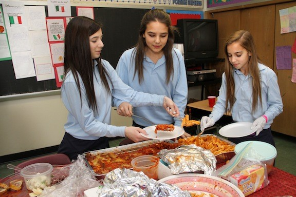 Seventh graders Ali Bianco, Victoria Romano and Lauren Sommers dished out Italian fare for visitors in their Italian classroom at Our Lady of Lourdes School.