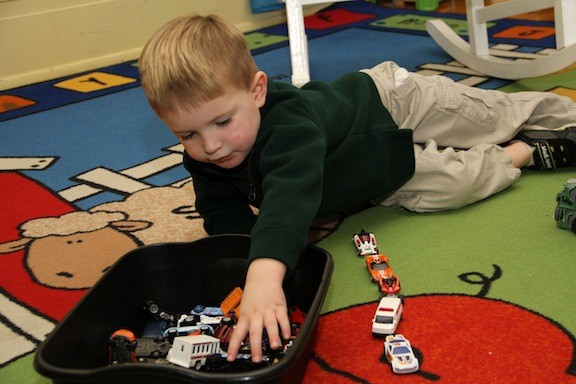 Colin Masse played around with toy trucks in his Pre-K classroom.