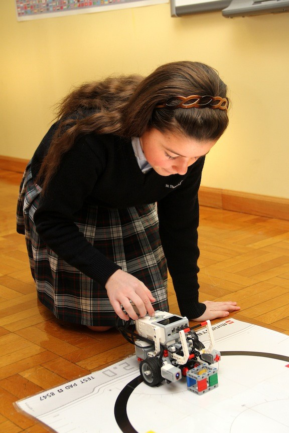 Bridget Lapham demonstrated her robotics project for a crowd at St. Thomas the Apostle School.