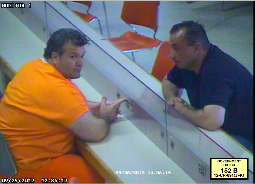 Joseph Romano, 51, of Levittown, left, talking with co-conspirator Dejvid Mirkovic at the Nassau County Correctional Center on Sept. 25, 2012.