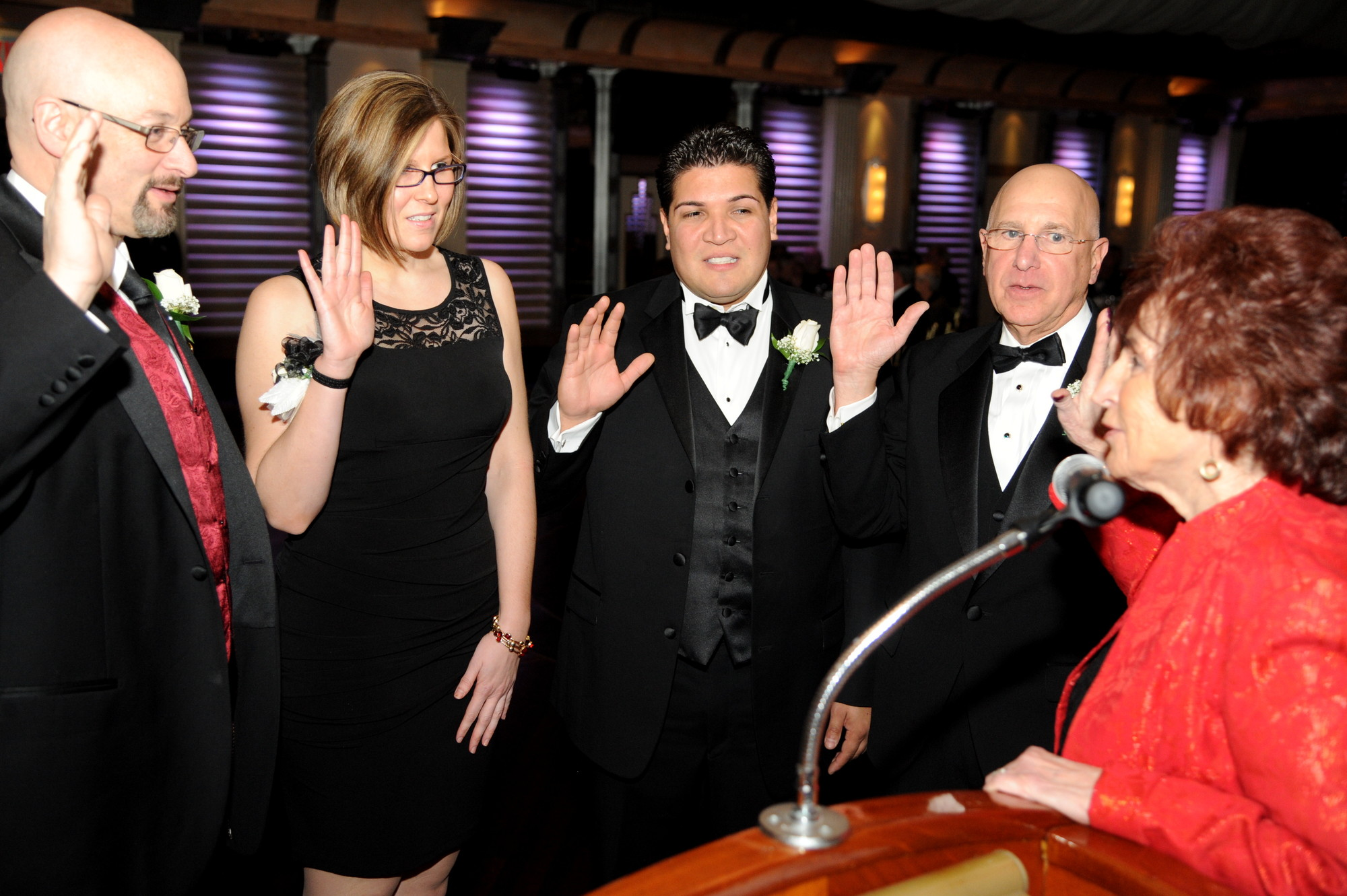 Nassau County Legislature Presiding Officer Norma Gonsalves swore in officers Mitchell Allen, left, Lyndsey Gallagher, Will Miranda and Warren Kalmenson during the dinner.