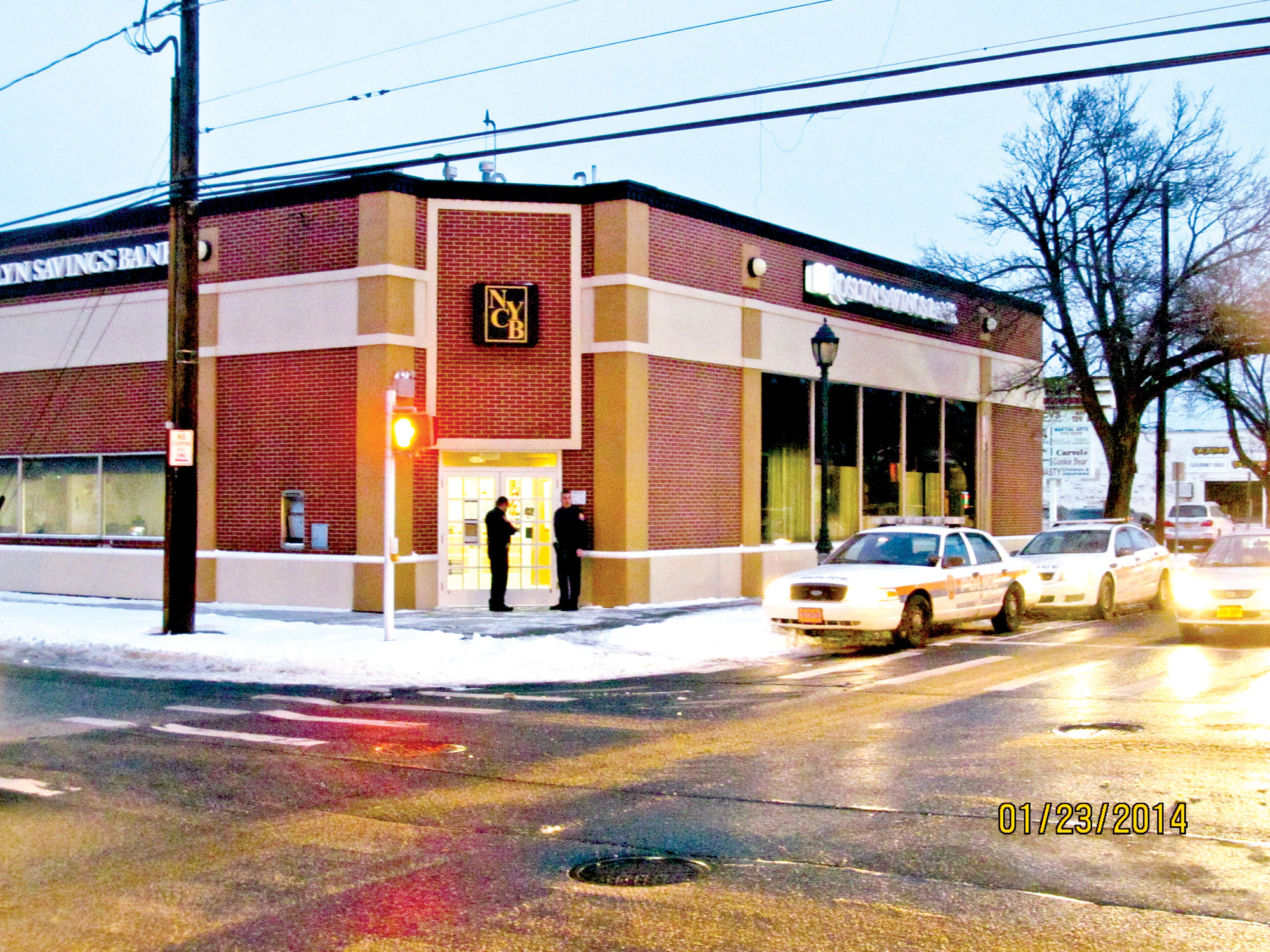 Police officers responded on Jan. 23 to Roslyn Savings Bank at Merrick Avenue and Smith Street after a robbery occurred there.
