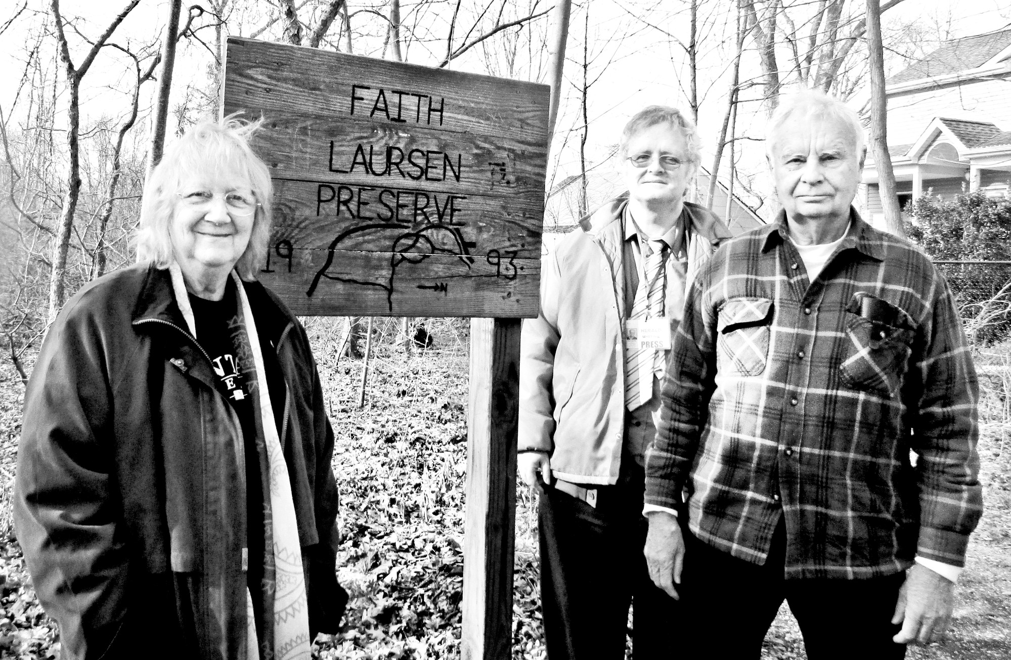 Paul Laursen, second from left, son of Faith Laursen, joined Barbara and Bill Wood, members of the Friends of the Faith Laursen Preserve, outside the 25-acre nature reserve.