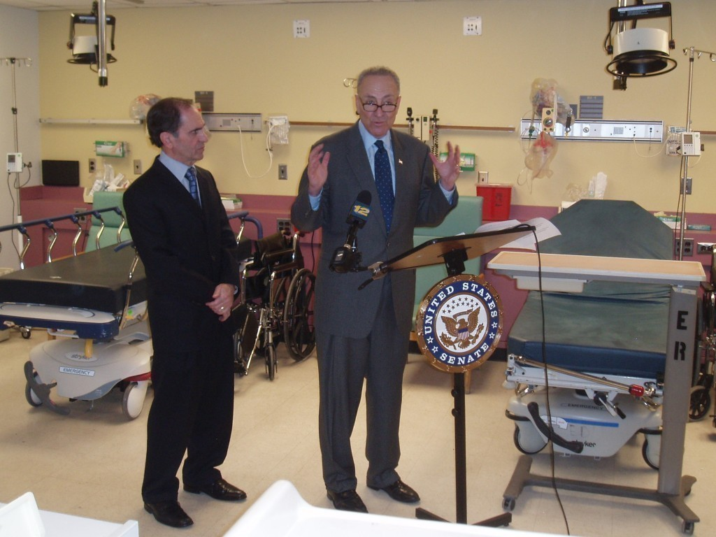 Sen. Charles Schumer, with LBMC CEO Doug Meltzer, left, spoke inside the shuttered hospital's emergency department, which was ready to reopen last June.