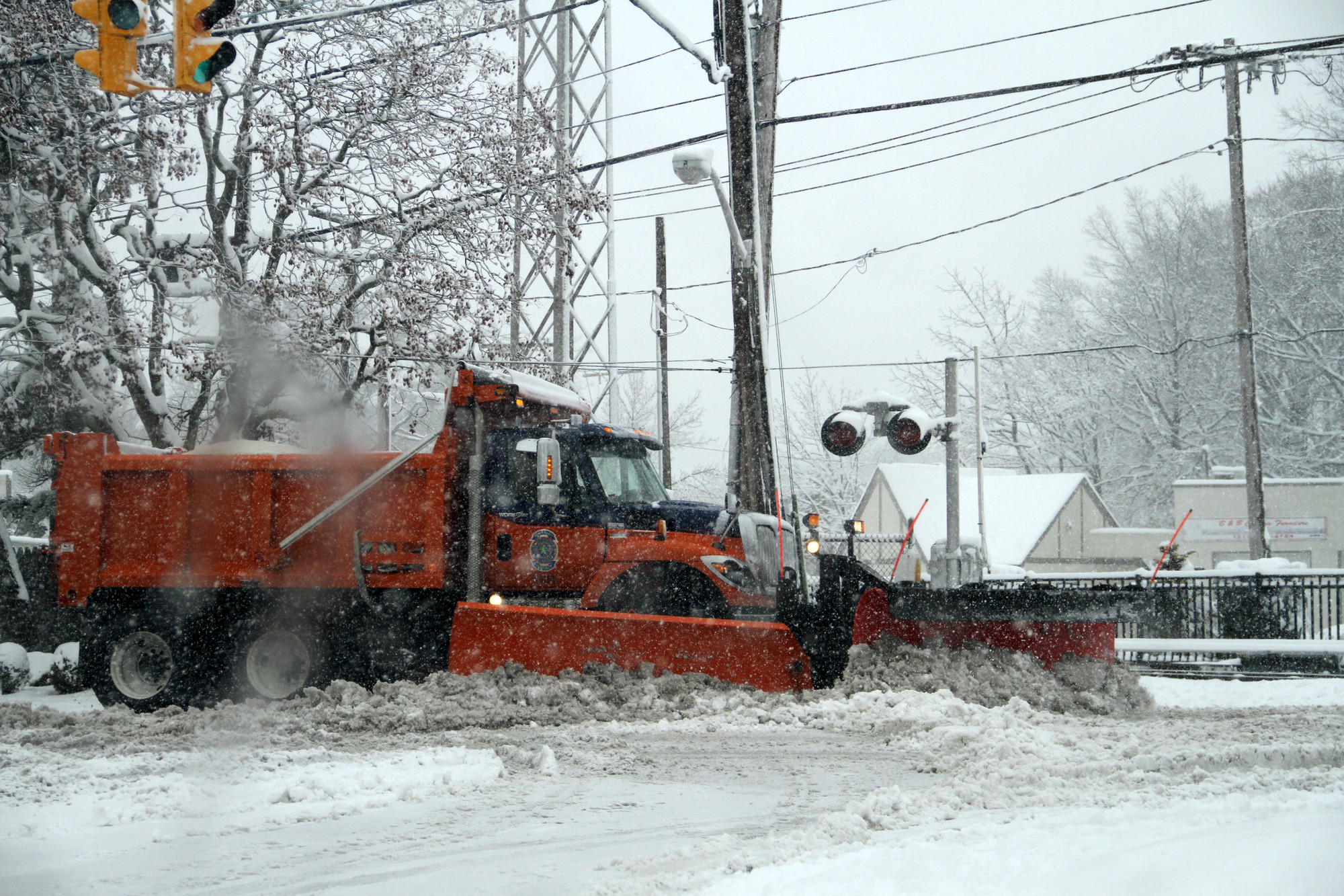 The Malverne Department of Public Works deployed its plows on Monday to keep the village's business district functional.