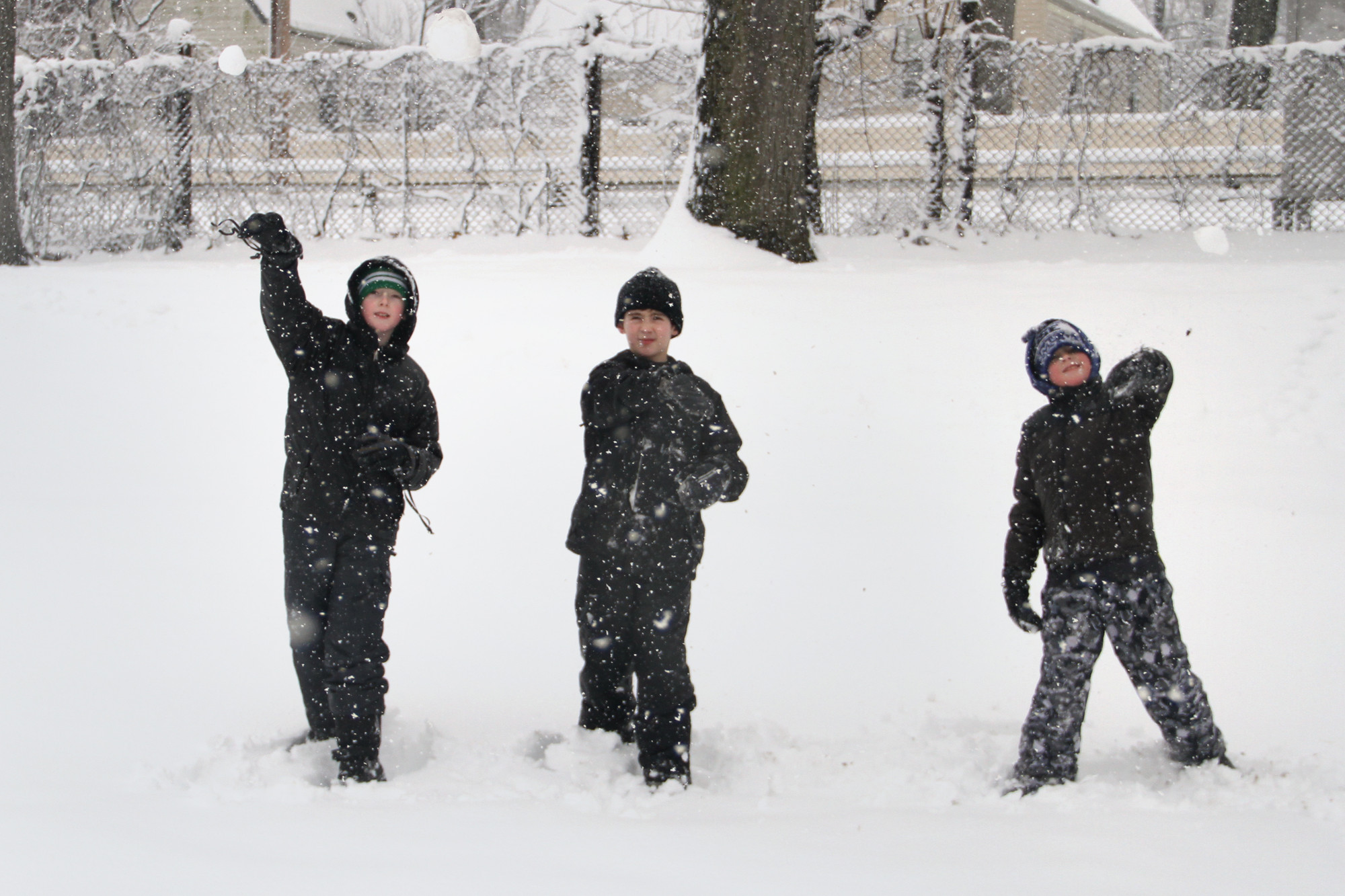 Brendan Gorman, Trevor Wallace and John Gorman tossed snowballs in Gaddis Park in Westwood, Malverne.