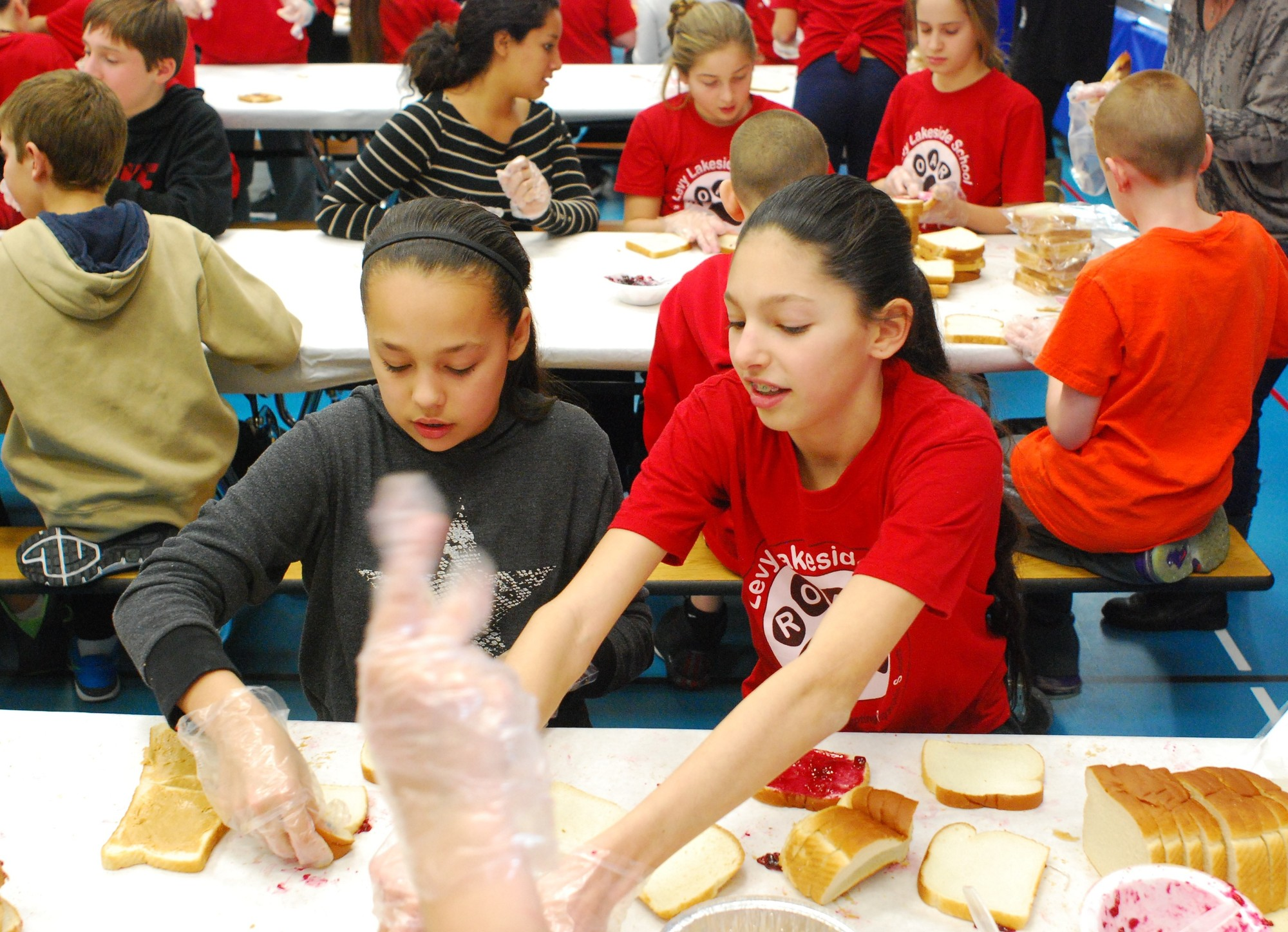 Sophia Marino and Samantha Loew worked together to assemble the sandwiches.