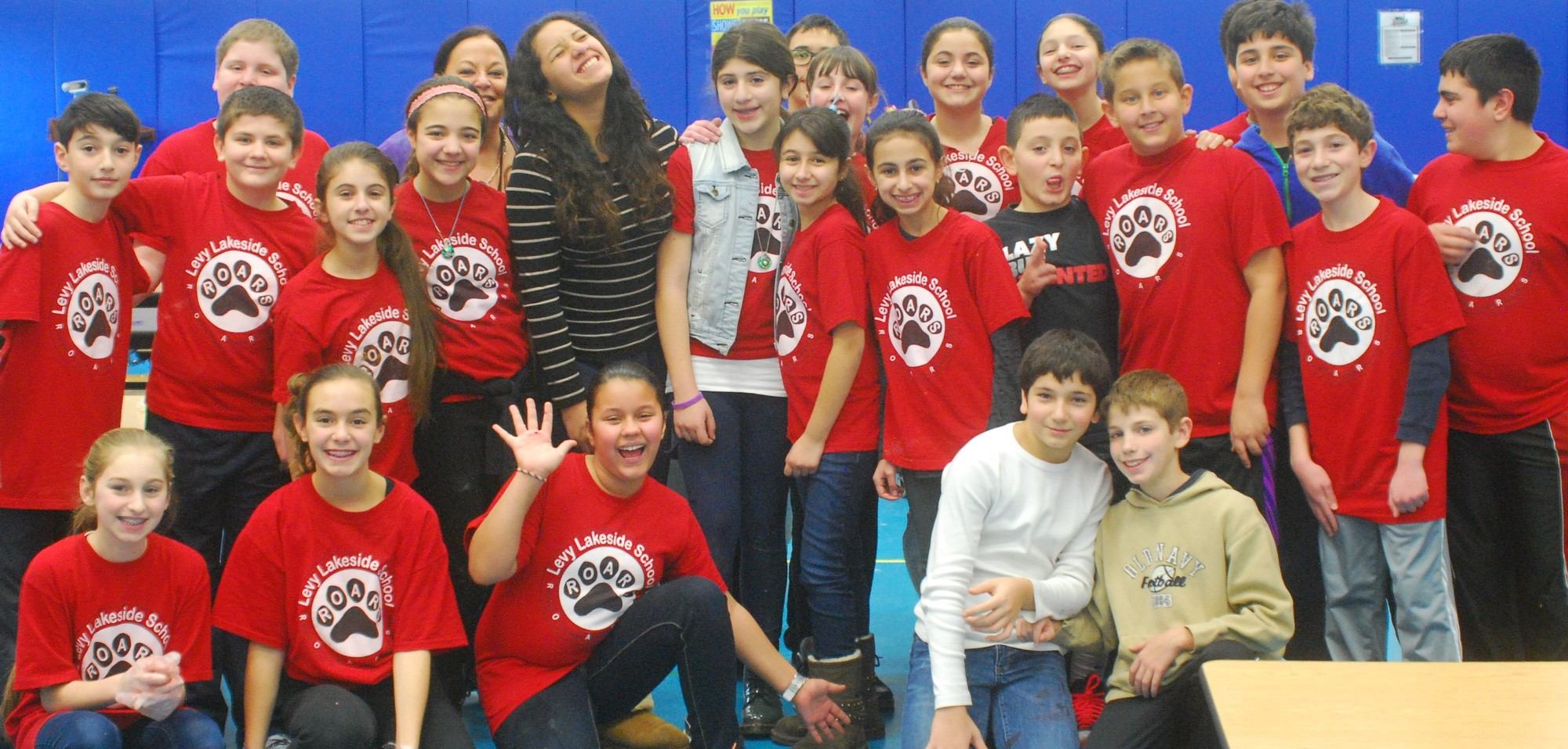 Sue Molloy's sixth-graders were all smiles after an afternoon of charity work.