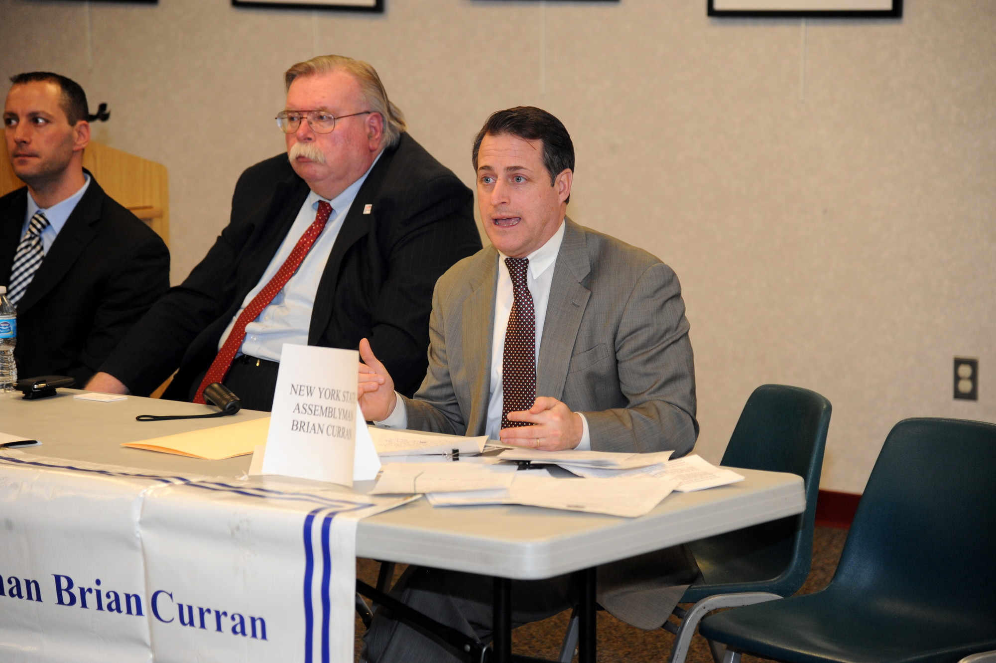 State Assemblyman Brian Curran addressed local concerns about the Long Island Rail Road with MTA official Robert Brennan, left, during an open forum at the Rockville Centre Library on Jan. 30.