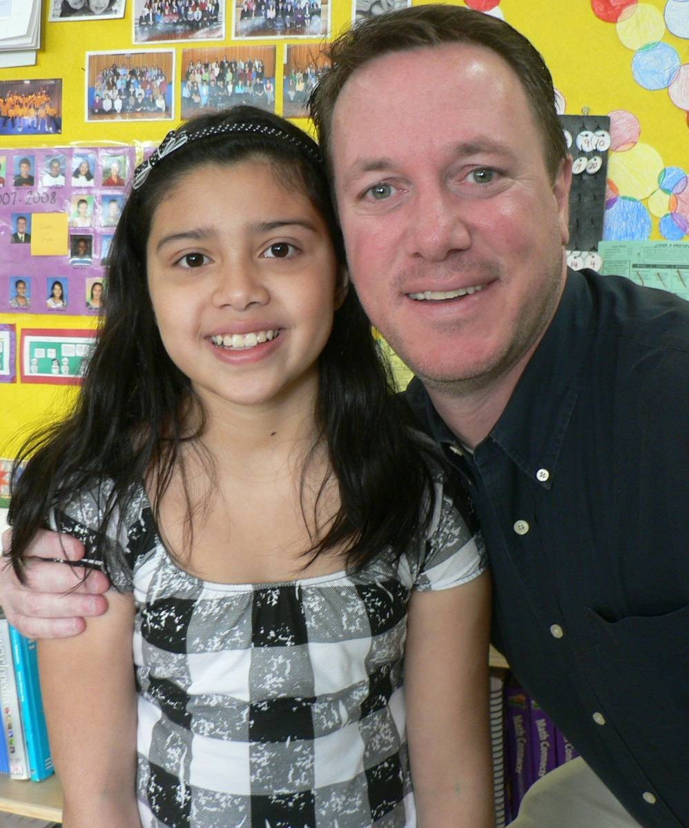 Cindy Garcia, here with her fifth-grade teacher Richard Mansfield, graduated from Clear Stream Avenue School in Valley Stream District 30, before transferring into the Malverne school district in ninth grade.