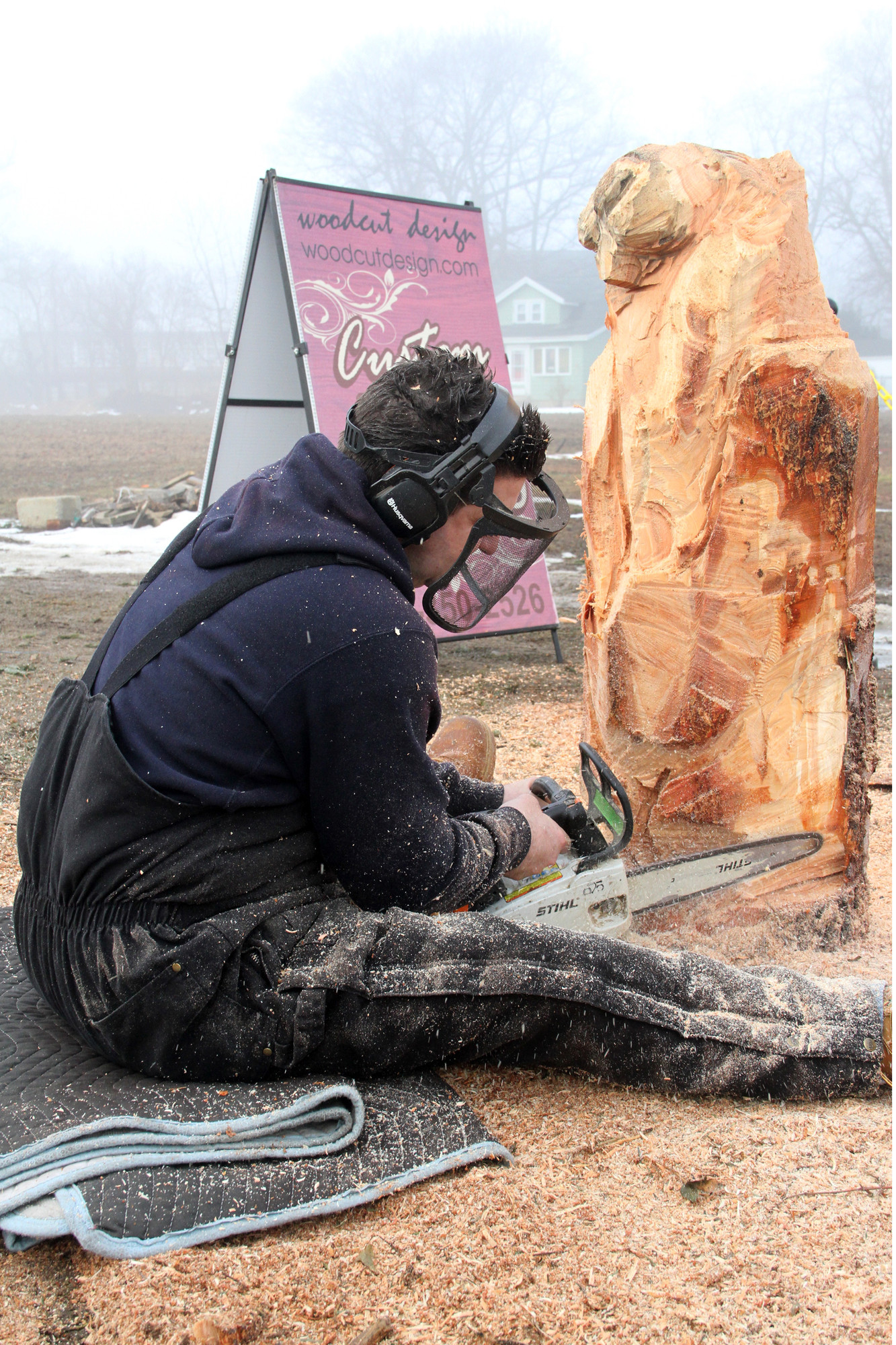 Woodcarver Craig Mastandrea worked his magic to create a new Mel sculpture at this year's event.