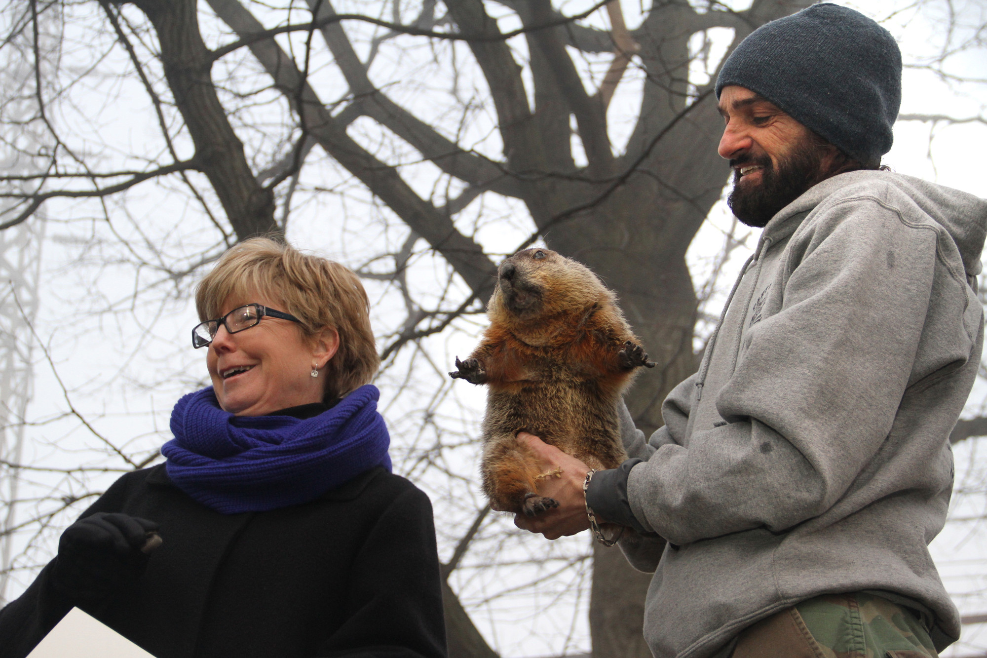 Mayor Patricia McDonald conferred with Malverne Mel, the village's great prognosticator, alongside his handler, Andre Ricaud, to announce his prediction of an early spring this year.