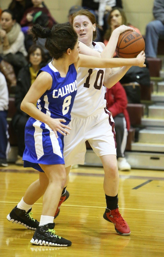 Mepham's Bridgid McNeill, right, who had 17 points and 11 rebounds, looked to avoid Calhoun's Nora Charidah.