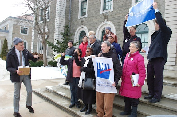 Members of the Nassau United Redistricting Coalition demonstrated on the steps of the Theodore Roosevelt Executive Building on Jan. 27.