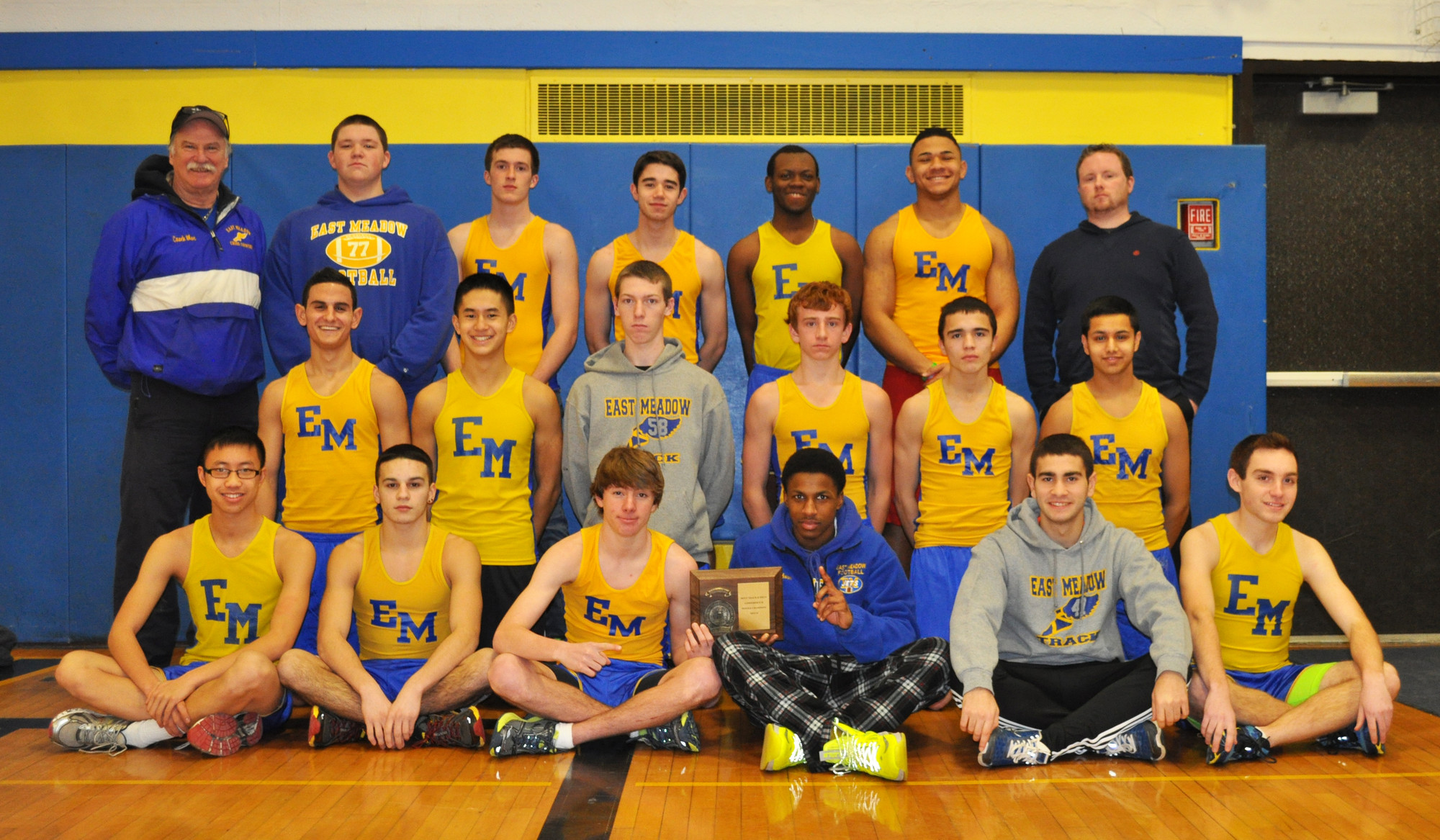 East Meadow High's conference champion winter track team, at top left, coach Jim McGlynn, Matthew Mascia, Joe Puciloski, Michael Walsh, Jay Robinson, Chika Ewulu, coach Michael Ringhauser, middle row, from left, Prabhnoor Multani, Chris Delgado, Tim Euler, Jake Healy, Peter Vo, Eric Gershoff, and bottom row, from left, Alex Wong, Christian Torres, Mike Grady, Tim Gibson, Rui Cunha and Rob Barracca.    Photo by Tony Belissimo/Herald
