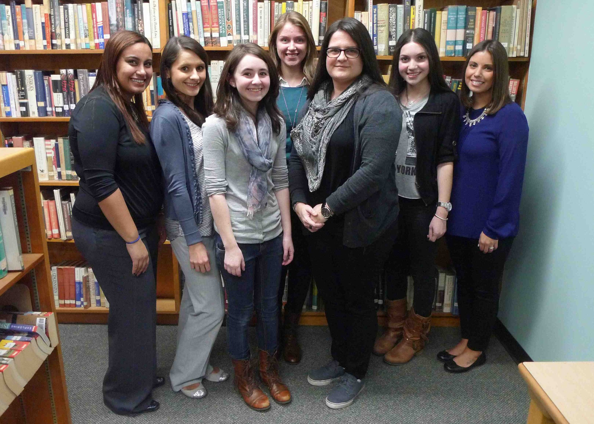 "Kennedy High School English Chairwoman Sally Maya, Kim Miller, third-place winner Nicole Homburger, first-place winner Olivia Schmidt, Vivian Lopez, second-place winner Amanda Aronoff and Catherine Arresto celebrated at the school's ""Poetry Out Loud"" competition."