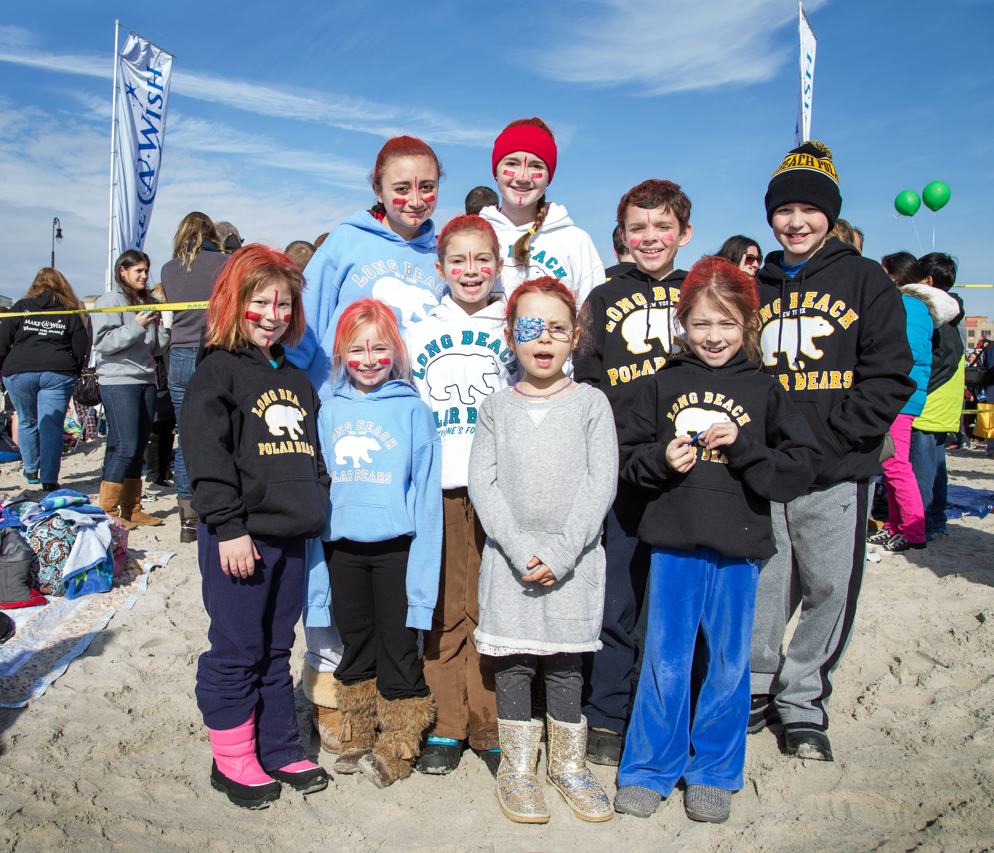 Sean Nidermaier, 11, top, second from right, received a wish five years ago, and has come to the Polar Bear Splash every year since. Friends and family who joined him this year included, clockwise from top left, Kristen Granieri, 14, Emma Nidermaie, 14, Matthew Loftus, 11, Ava Loftus, 6, Braidy Nidermaier, 6, Caitlin Nidermaier, 9, Mikayla Haberlack, 6, and Alyssa Haberlack, 8.
