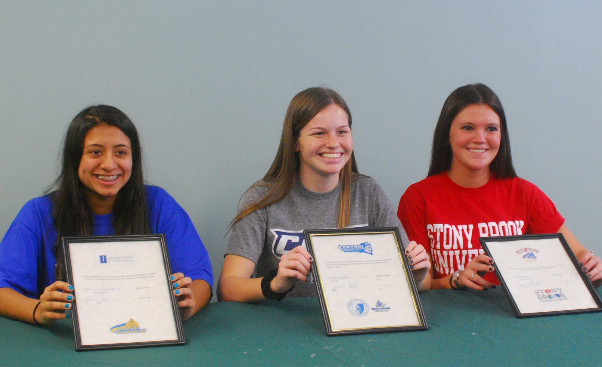 Kennedy soccer players, from left, Leanna Rodriguez, Nicole Liotta and Franki Priore committed to playing college ball next fall during a signing ceremony at Kennedy on Feb. 5, which was National Signing Day.